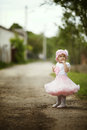 Little girl in dress outdoor photo cute Royalty Free Stock Photo