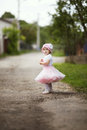 Little girl in dress outdoor photo cute Royalty Free Stock Image
