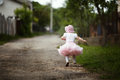 Little girl in dress running away cute Royalty Free Stock Photos