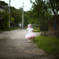Little girl in dress running away cute Royalty Free Stock Photography