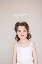 Little girl dressed as an angel a enjoying her halo and outfit at christmas Stock Photos