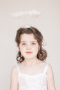 Little girl dressed as an angel a enjoying her halo and outfit at christmas Stock Photography