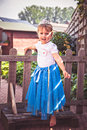 Little girl dressed up as a princess happy outdoors Royalty Free Stock Image
