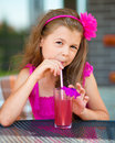 Little girl is drinking cherry juice Royalty Free Stock Photo