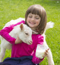 Little girl drinking healthy goat milk on a meadow Stock Images