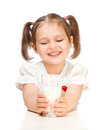 Little girl drinking milk Stock Images