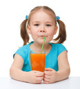 Little girl drinks orange juice Stock Photo