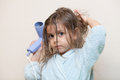 Little girl drying her hair Royalty Free Stock Photo