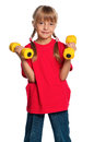 Little girl with dumbbells Royalty Free Stock Photo