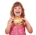 Little girl eat big sandwich on white Stock Image