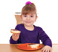 Little girl eat bread chocolate cream Royalty Free Stock Images