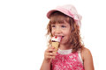 Little girl eat ice cream Stock Images