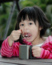 Little girl eat lunch cute open wide mouth for Royalty Free Stock Photo