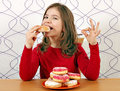 Little girl eat sweet donuts Royalty Free Stock Photo