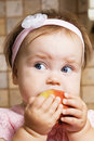Little girl eating an apple Royalty Free Stock Photography