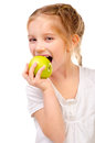 Little girl eating apple isolated on a white background Royalty Free Stock Image