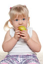 Little girl eating an apple portrait of a Royalty Free Stock Photography