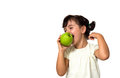 Little girl eating apple portrait of a isolated on white Royalty Free Stock Photos
