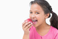 Little girl eating apple on white background Royalty Free Stock Image
