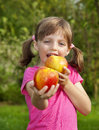 Little girl eating an apples Royalty Free Stock Photo