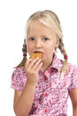 Little girl eating a biscuit. Royalty Free Stock Photo
