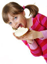 Little girl eating a bread with cheese Stock Photography
