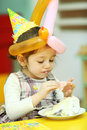 Little girl eating cake on her birthday Stock Photography