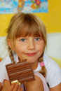 Little girl eating chocolate Royalty Free Stock Photos