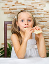 Little girl eating an chocolate Royalty Free Stock Photo