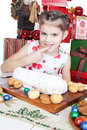 Little girl eating Christmas cake Royalty Free Stock Image