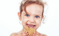 Little girl eating a cookie Royalty Free Stock Photo