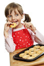 Little girl eating cookies Royalty Free Stock Photo