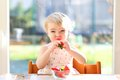 Little girl eating delicious strawberries Royalty Free Stock Photo