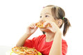 Little girl eating food Royalty Free Stock Photo