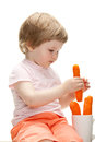 Little girl eating fresh carrot Royalty Free Stock Images