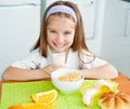 Little girl eating her breakfast at home Stock Images