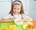 Little girl eating her breakfast at home Stock Images