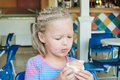 Little girl eating ice cream in a cafe Stock Photo