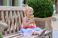 Little girl eating ice cream cone in the city Royalty Free Stock Photo