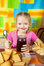 Little girl eating marmalade Stock Photos