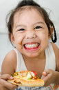 Little girl eating pizza and smile Royalty Free Stock Photography