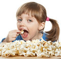 Little girl eating popcorn Stock Photos