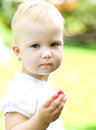 Little girl eating raspberry Royalty Free Stock Photo