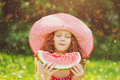 Little Girl eating red watermelon. Royalty Free Stock Photo