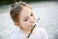 Little girl eating roasted marshmallow Royalty Free Stock Photo