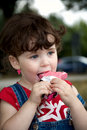Little girl is eating strawber Royalty Free Stock Photography