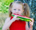Little girl eating watermelon Royalty Free Stock Photo