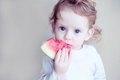 Little girl eating watermelon Stock Photography
