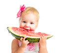 Little girl eating watermelon isolated on white Royalty Free Stock Image