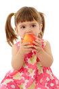 Little girl eating yellow apple Royalty Free Stock Photo